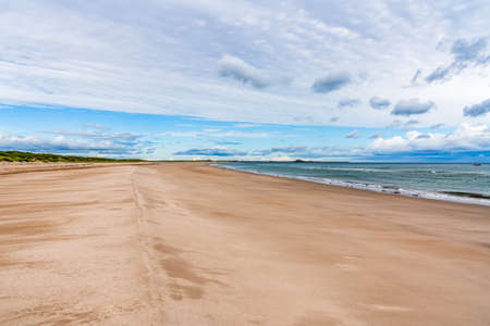 The Beach at Ross Sands, near Seahouses in Northumberland, England, UK Stock Photo