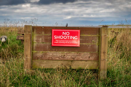 Sign: No shooting, this is private land and anyone caught shooting will be prosecuted - seen near Beal in Northumberland, England, UK