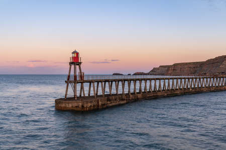Whitby, North Yorkshire, England, UK - the East Pier, seen from the West Pier