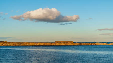 A cloud over the East Pier in Whitby, North Yorkshire, England, UK Stock Photo