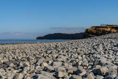 The stones of Kilve Beach in Somerset, England, UK - looking over the Bristol Channel