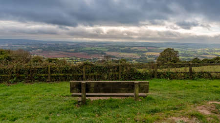 A bench with view over the Quantock Hills landscape near West Bagborough, Somerset, England, UK Stock Photo - 117287663