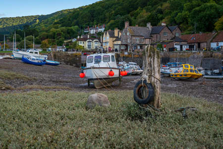 Porlock Weir, Somerset, England, UK - October 01, 2018: Boats in the harbour at low tide Redactioneel