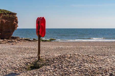 Lifebuoy at Otterton Ledge in Budleigh Salterton, Jurassic Coast, Devon, UK