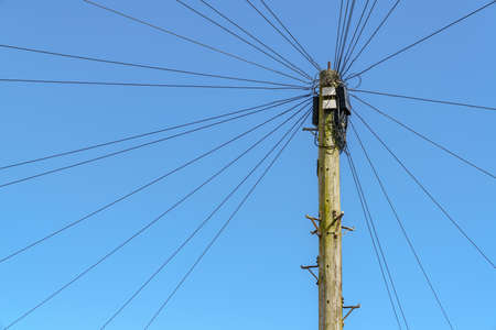 Power cables and power pole, seen in Exmouth, Devon, England, UK