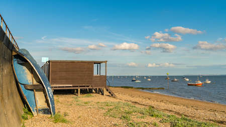 Beach huts on the shore of the River Thames, seen in Southend-on-Sea, Essex, England, UK