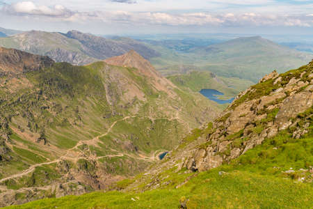 View from the summit of Mount Snowdon, Snowdonia, Gwynedd, Wales, UK - looking north at Garnedd Ugain, the Pyg Track and the Miners Track