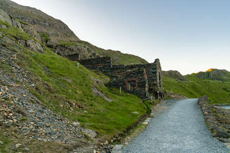 Walking on the Miners track, Snowdonia, Wales, UK - passing Llyn Lydaw and the Mine Works ruin