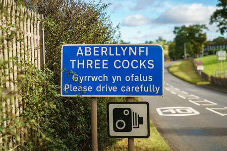 Sign: Three Cocks Please drive carefully (Welsh & English)
