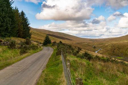 Rural road on a cloud day, near Ystradfellte in Powys, Wales, UK Imagens