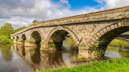 Atcham Old Bridge over the River Severn in Atcham, near Shrewsbury, Shropshire, England, UK Reklamní fotografie