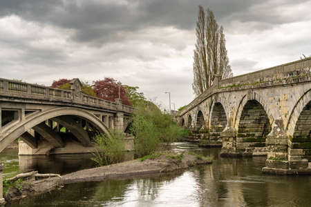 The old bridge and Atcham Bridge over the River Severn in Atcham, near Shrewsbury, Shropshire, England, UK