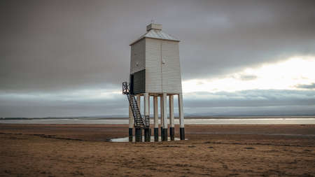 A cloudy evening at the Low Lighthouse in Burnham-on-Sea, Somerset, England, UK