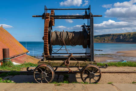 An old rope winch on the North Sea coast in Runswick Bay, North Yorkshire, England, UK Stock Photo