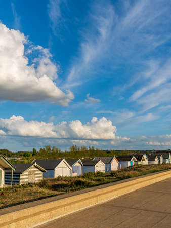 Clouds over the Beach Huts at the North Beach in Heacham, Norfolk, England, UK
