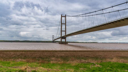 Grey clouds over the Humber Bridge, seen from Barton-Upon-Humber in North Lincolnshire, England, UK