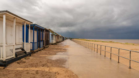 Grey clouds over the Beach Huts in Sandilands, Lincolnshire, England, UK Reklamní fotografie