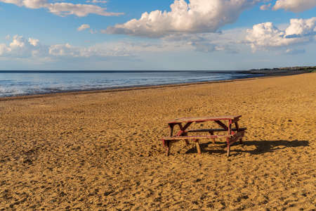 A picnic bench and table on Heacham South Beach, Norfolk, England, UK Stock Photo