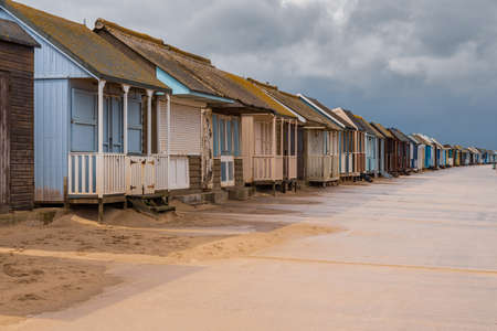 Grey clouds over the Beach Huts in Sandilands, Lincolnshire, England, UK Stock fotó