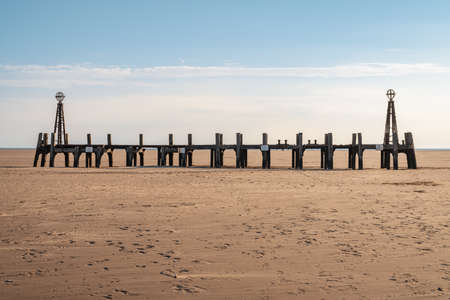 St Anne's Beach with the remains of the pier's landing jetty, seen in St Anne's, Lancashire, England, UK