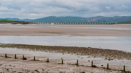 Low tide at Morecambe Bay with Leven Viaduct in the background, seen from Canal Foot, Cumbria, England, UK