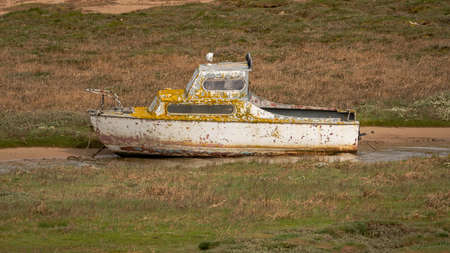 The wreck of a boat in the grass, seen in Askam-in-Furness, Cumbria, England, UK