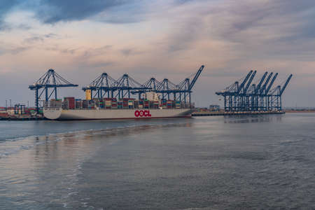 Felixstowe, Suffolk, England, UK - April 23, 2019: A container ship and port cranes in Felixstowe Harbour