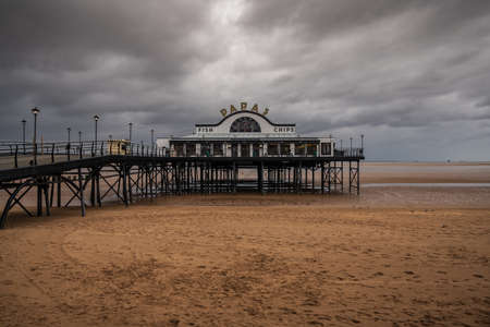 Cleethorpes, North East Lincolnshire, England, UK - April 27, 2019: Grey clouds over The Pier