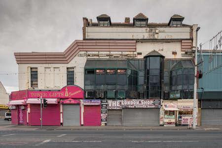Blackpool, England, UK - April 28, 2019: A closed shop on the Promenade Редакционное