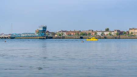 Knott End-on-Sea, Lancashire, England, UK - April 30, 2019: View over the River Wyre towards Fleetwood Редакционное