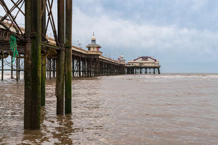Blackpool, England, UK - April 28, 2019: Dark clouds over the the North Pier