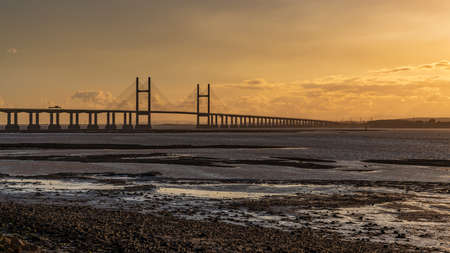 Golden Hour at the The Prince of Wales Bridge and the River Severn, seen from Redwick, South Gloucestershire, England, UK