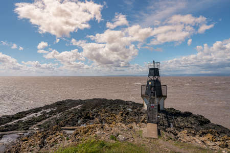 The Portishead Point Lighthouse with the Bristol Channel in the background, seen in Portishead, North Somerset, England, UK