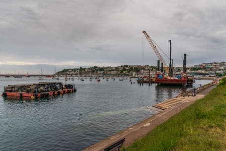 Brixham, Torbay, England, UK - June 06, 2019: View over Brixham Harbour
