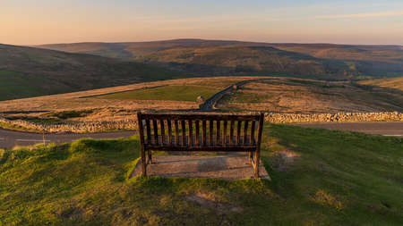 A bench with a view, seen at the Buttertubs Pass (Cliff Gate Rd) near Thwaite, North Yorkshire, England, UK