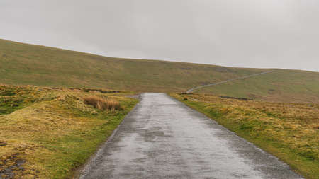 A rainy day on the B6270 road between Birkdale and Nateby, Cumbria, England, UK Фото со стока