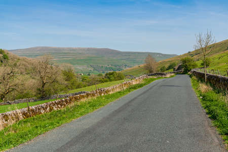 Rural road in the Upper Wharfedale near Yockenthwaite, North Yorkshire, England, UK