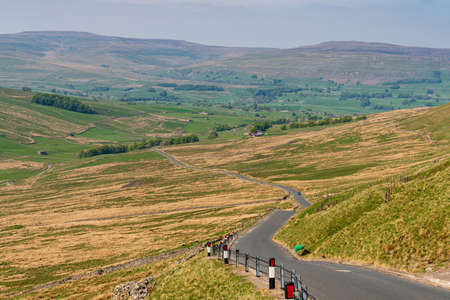 Rural road in the Yorkshire Dales near Oughtershaw, North Yorkshire, England, UK
