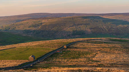 Golden hour over the Swaledale and Black Hill, seen from the Buttertubs Pass (Cliff Gate Rd) near Thwaite, North Yorkshire, England, UK