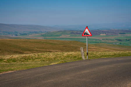 Sign: 14% descent, seen on the B6270 road between Birkdale and Nateby, Cumbria, England, UK