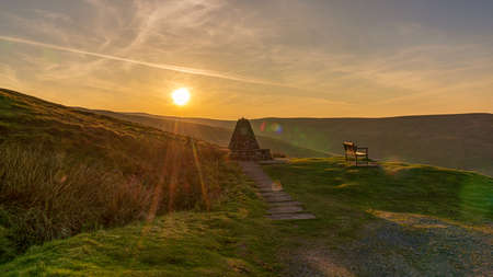 Sunset and a bench with a view, seen at the Buttertubs Pass (Cliff Gate Rd) near Thwaite, North Yorkshire, England, UK