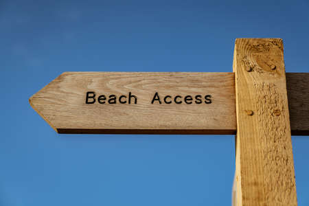 Sign: Beach Access - with blue sky in the background