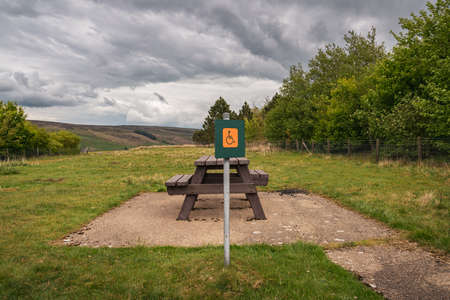 A picnic bench for wheelchair users, seen at the Scar House Reservoir, North Yorkshire, England, UK Zdjęcie Seryjne