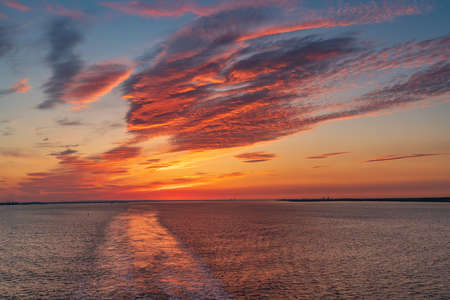 Sunset and evening clouds over the River Humber near Sunk Island, East Riding of Yorkshire, England, UK