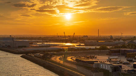 Kingston upon Hull, England, UK - May 22, 2019: The setting sun over the ferry terminal