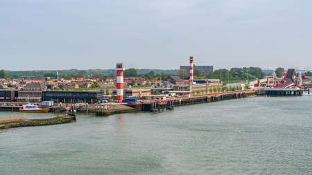 Hook of Holland, Rotterdam, South Holland, Netherlands - April 23, 2019: The harbour and coast, with the lighthouses and the ferry terminal