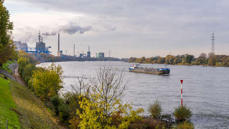 Duisburg, North Rhine-Westfalia, Germany - November 11, 2019: Ships on the River Rhine, seen from the Rheinpromenade Wanheim