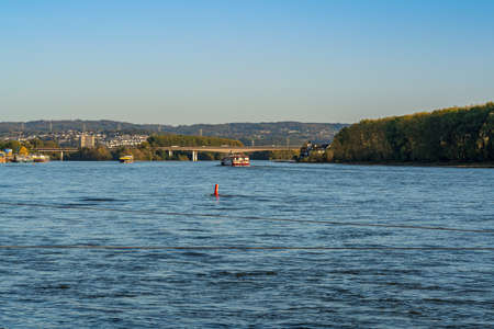 Neuwied, Rhineland-Palatine, Germany - October 14, 2019: View at the River Rhine from Engers, with the motorway bridge in the background Editöryel