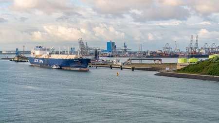 Rotterdam, South Holland, Netherlands - May 10, 2019: View from the Calandkanaal towards the industry and ships at the shore of Europoort