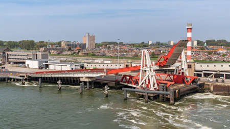 Hook of Holland, Rotterdam, South Holland, Netherlands - April 23, 2019: The harbour and coast, with the lighthouse and the ferry terminal Editöryel